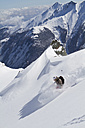 Austria, Kaprun, Kitzsteinhorn, Man skiing in powder snow - FFF001125