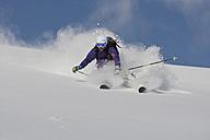 Austria, Tyrol, Kitzbühel, Man skiing in powder snow - FFF001128