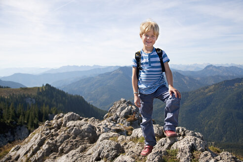 Germany, Bavaria, Boy (4-5 Years) standing mountain, smiling, portrait - HSIF000025