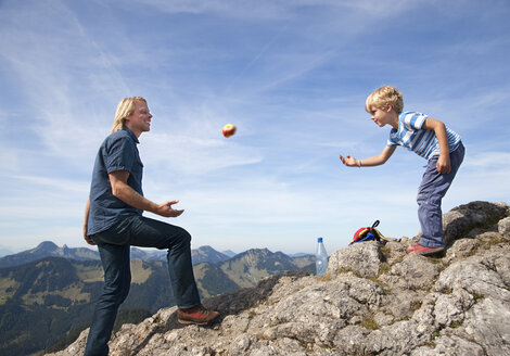 Germany, Bavaria, Father and son (4-5 Years) playing on mountain summit - HSIF000014