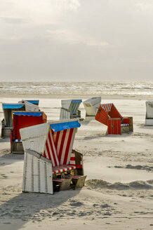 Germany, Schleswig Holstein, View of beach chair near St Peter Ording - RNF000571