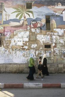 Amman, Woman with boys walking on footpath - PM000841