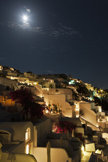 Greece, Cyclades, Thira, Santorini, View of Oia at night with full moon - FOF002840