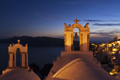 Greece, Cyclades, Thira, Santorini, View of bell tower and oia after sunset - FOF002846