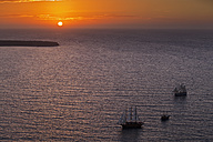 Europe, Greece, Thira, Cyclades, Santorini, View of sailing ships in aegean sea at sunset - FOF002783