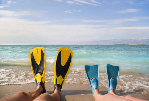 Croatia, Zadar, Couple with flippers relaxing on beach - HSIF000037