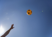 Croatia, Zadar, Girl throwing ball in the air - HSIF000027