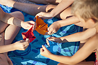 Croatia, Zadar, Children making paper boat - HSIF000033
