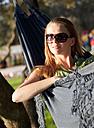 Croatia, Zadar, Young woman resting in hammock - HSIF000074