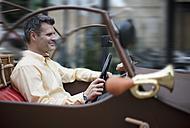 Croatia, Zagreb, Man in oldtimer car, smiling - HSIF000120