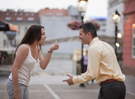 Croatia, Zagreb, Woman and man arguing on street - HSIF000121