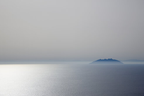Italy, Tuscany, View of montecristo island in sea at dusk - HSIF000068