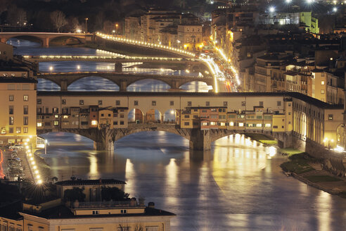 Italy, Tuscany, Florence, View of Bridge on Arno River at night - RUEF000557
