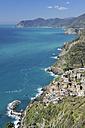 Italy, Cinque Terre, La Spezia Province, Riomaggiore, Liguria, View of traditional fishing village - RUEF000573