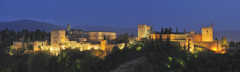 Spain, Andalusia, Granada Province, View of Alhambra Palace illuminated at dusk - RUEF000616
