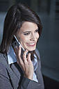 Germany, Bavaria, Business woman on the phone, smiling - MAEF002696