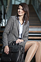 Germany, Bavaria, Business woman looking away, smiling - MAEF002710