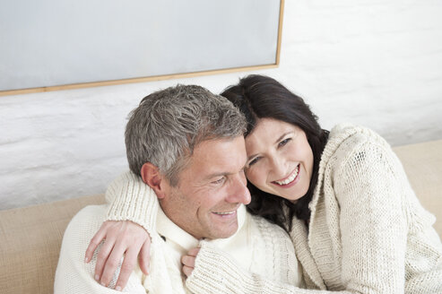 Germany, Munich, Mature couple at home, smiling - NHF001304