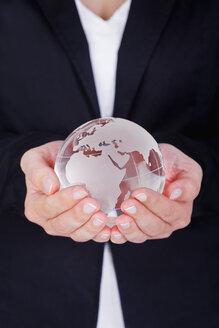 White globe in woman hand - TSF000131