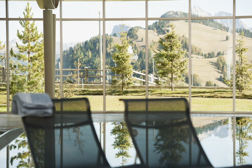 Italy, South Tyrol, Swimming pool  and sun lounger in hotel urthaler - WESTF015889