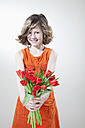 Girl with flowers for mother's day, smiling, portrait - MAEF003073