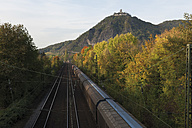 Europe, Germany, North Rhine-Westphalia, Middle Rhine, Bad Honnef, Siebengebirge, Train passing near drachenfels castle - CS014347
