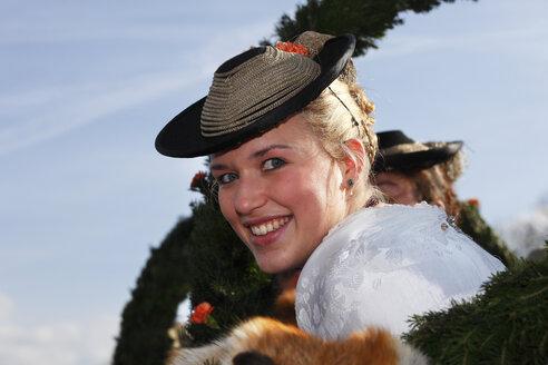 Europe, Germany, Upper Bavaria, Bad Toelz, Young woman celebrating leonhardi procession, smiling - SIE000017