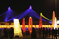 Germany, Bavaria, Munich, People in winter tollwood festival at night - SIE000063