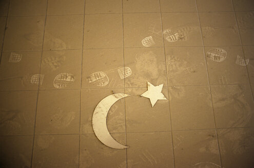 Amman, Jordan, View of crescent and star on dusty floor - PMF000873