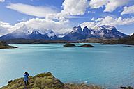 South America, Chile, Patagonia, Female photographer capturing an image ot torres del paine mountains - FOF003010