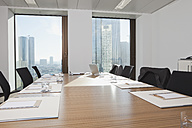 Germany, Frankfurt, Conference room table ready for meeting - SKF000421