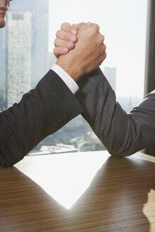 Germany, Frankfurt, Businessmen doing arm wrestling - SKF000514