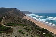 Portugal, Algarve, Sagres, Tourist on praia da condoama - WVF000115