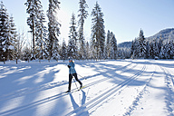 Germany, Bavaria, Isar Valley, Senior woman doing cross country skiing - MIRF000090