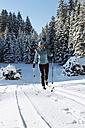 Germany, Bavaria, Isar Valley, Senior woman doing cross country skiing - MIRF000093