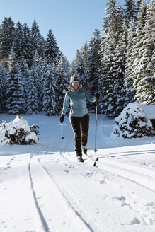 Germany, Bavaria, Isar Valley, Senior woman doing cross country skiing - MIRF000093