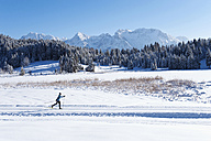Germany, Bavaria, Isar Valley, Senior woman doing cross country skiing - MIRF000096