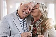 Germany, Wakendorf, Senior woman kissing man, portrait - WESTF016234