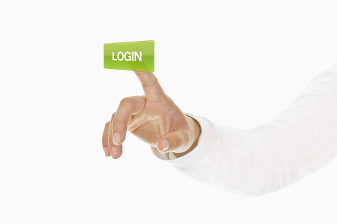 Human hand touching login button - TSF000153