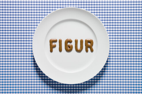 Word figur written with russian bread on dish, close up - MUF000988