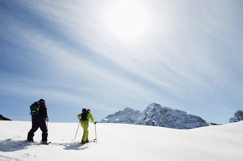 Austria, Kleinwalsertal,  Couple skiing - MRF001252