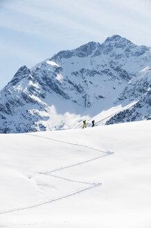Austria, Kleinwalsertal,  Couple skiing - MRF001255