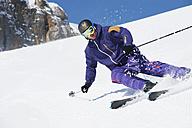 Austria, Kleinwalsertal, Man skiing - MRF001267