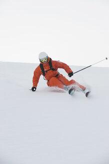 Austria, Kleinwalsertal, Man skiing, low angle view - MRF001273