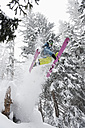 Austria, Kleinwalsertal, Male skier jumping mid-air, low angle view - MRF001276