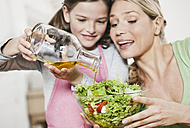 Germany, Cologne, Mother and daughter preparing salad - WESTF016300