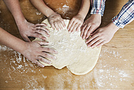 Germany, Cologne, Mother and children kneading dough - WESTF016381
