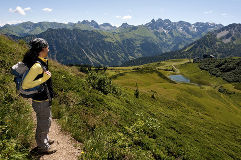 Germany, Bavaria, Allgaeu Alps, Woman standing with looking at view - UMF000310