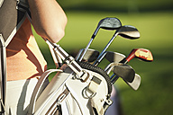 Italy, Kastelruth, Mid adult woman with golf bag, close up - WESTF016475