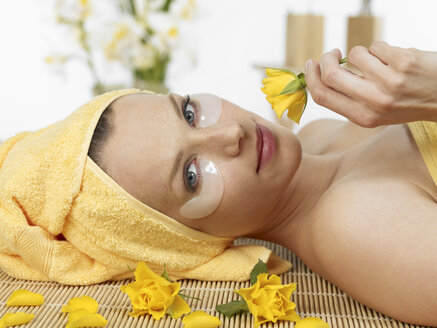 Young woman at spa with flower - JLF000359